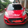 Peugeot tipe 107 thn 2016 A/T warna merah, km baru 12 rb