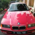BMW 318 merah thn 1998 manual mobil bagus & terawat
